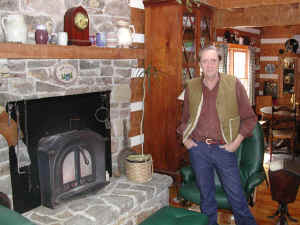 Volunteer Bob Markley in the home he built at Ice Mountain.
