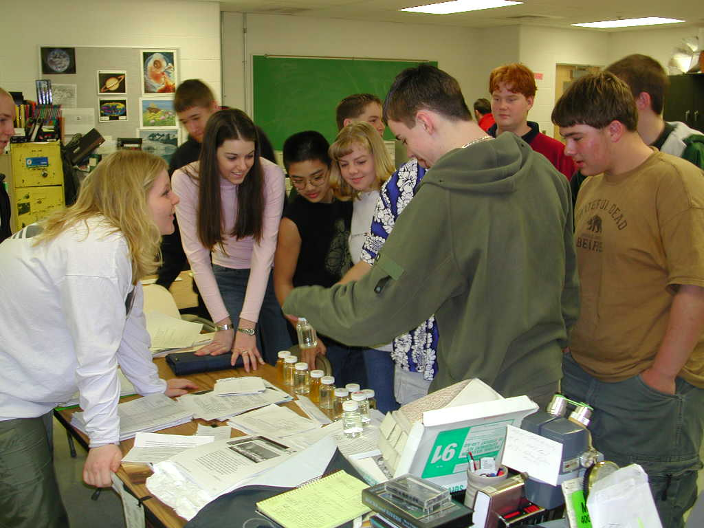 Students at Hampshire High School examine drinking water samples for bacteria.